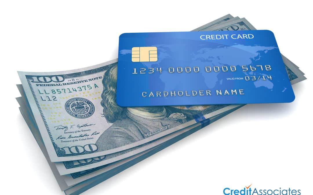 Cash underneath a credit card